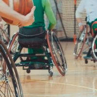 The image shows people playing wheelchair rugby