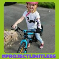 Child with prosthetic limb on a bike
